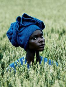 black woman in green field